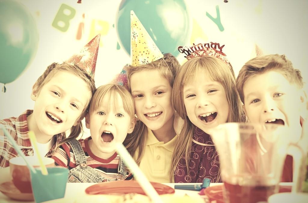 five kids at birthday celebration