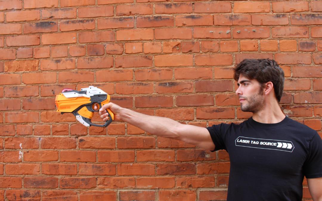 man pointing yellow hornet laser tag gun
